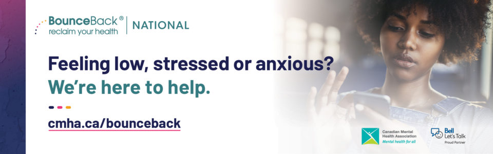 Feeling low, stressed or anxious? We're here to help. A young woman holds her smartphone.