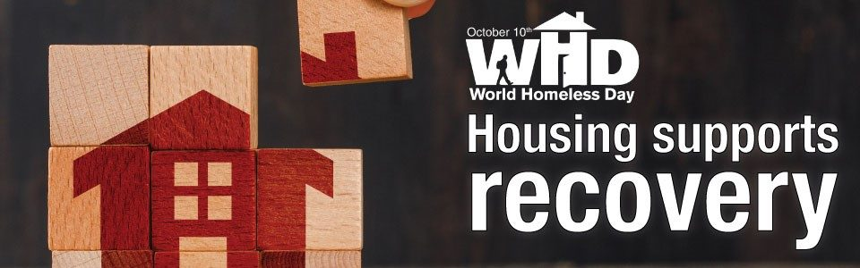 """The final piece of a puzzle is put in place, forming an illustration of a house; the text reads """"housing supports recovery"""""""